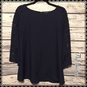 The limited navy sheer crochet 3/4 sleeve top